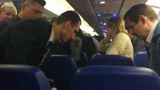 Mobile Phone Charger Catches Fire Aboard Aeroflot Flight to Volgograd - Video