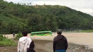 School Bus Driver Takes Risky Shortcut Through Flooded River - Video