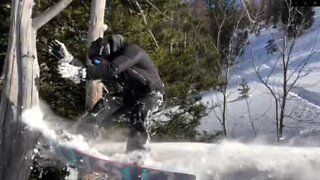 Snowboarder tries new trick and fails miserably
