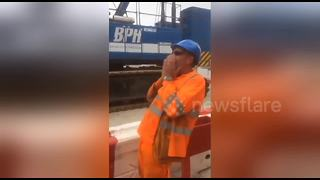 Construction workers pull colleague's tooth with string - Video