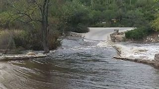 Severe Flooding In Canyon Submerges Bridge - Video