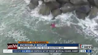 Incredible rescue at sea: surfer saves boater - Video