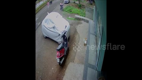 Lucky escape for scooter girl in bus smash