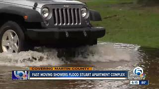 Fast moving showers flood Stuart apartment complex - Video