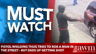 Pistol-wielding thug tries to rob a man in the street - but ends up getting SHOT - Video