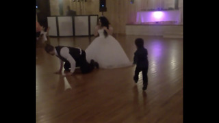 Funny kid helps Groom find garter  - Video