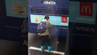 Daredevil Rollerblader Holds Onto Back of Bus in Dublin - Video