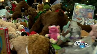 Motorcyclists donating toys to local charities