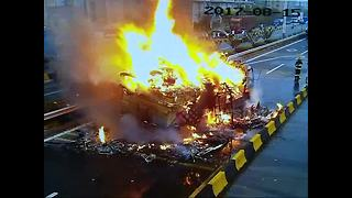 Lorry bursts into flames on road - Video