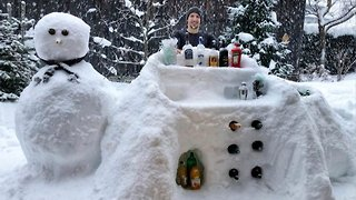 Giving on the rocks a new meaning: Creative man builds bar and bartender out of snow