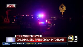Child, 2 hurt after car crashes into West Phoenix home