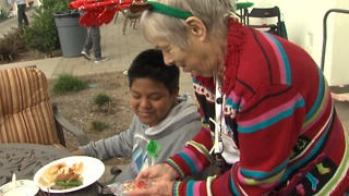 Seniors and child abuse survivors give hope to each other for the holidays - Video