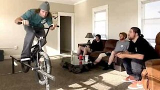 Guy shows off BMX skills in house during quarantine