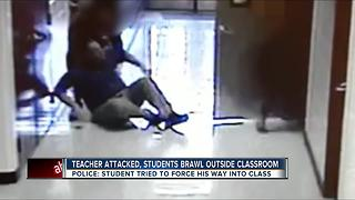 Teacher attacked, students brawl outside classroom - Video