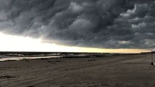 Storm Clouds Darken Sky at North Carolina Beach - Video