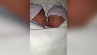 Twin Baby Chews Sister's Hand While Sleeping