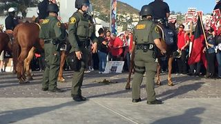 Police Monitor Opposing Protest Groups in Laguna Beach - Video