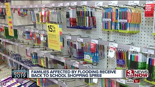 Flooding victims receive back to school shopping spree