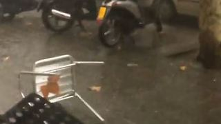 Storm Winds Blow Over Outdoor Seating at Barcelona Restaurant - Video