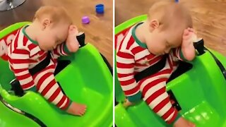 Little boy falls asleep in his electric bumper car