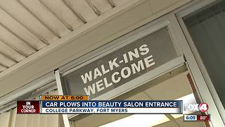 Car plows into salon - Video