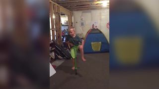 A Little Boy Makes Armpit Fart Sounds While Jumping On A Pogo Stick - Video