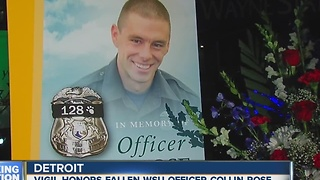 Slain officer remembered at vigil - Video