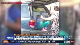 Woman accused of driving children in kennels to be arraigned - Video
