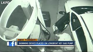 Skimming device placed on Longboat Key gas pump
