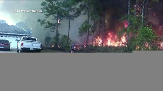 Crews battle large fire at Indian Lake Estates; 800 homes evacuated in Polk Co. - Video