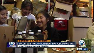 Volunteers pack up donations for volcano victims - Video
