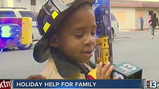 Firefighters deliver toys to Reesha Price and family - Video