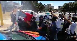 Police fire stun grenades and arrest tow Saftu members in Cape Town