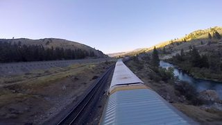 Drone racer performs amazing tricks around a moving freight train