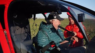 Son surprises dad with helicopter ride to a mountain they climbed decades prior