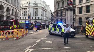 Fire and police vehicles assemble at Bank station during fire alert - Video