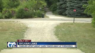 Families upset about cars towed away at fireworks - Video
