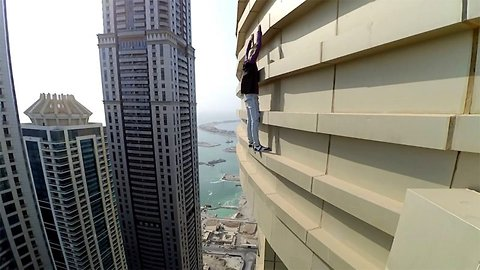 Terrifying moment daredevil climbs up a building