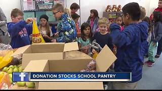 Donation stocks school's food pantry - Video