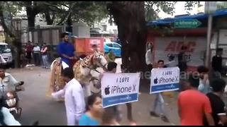 Mumbai man rides horse in ceremonial procession to buy iPhone X - Video