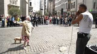 Elderly woman dances along to beatboxer in Brussels square - Video