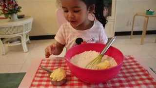 Toddler Shares Delicious Orange and Date Cake Recipe - Video