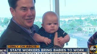 Governor Ducey working to expand program that allows state workers allowed to bring babies to work - Video