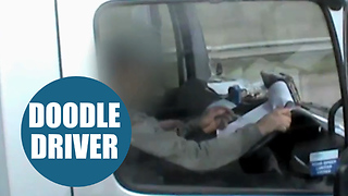 Shocking footage shows lorry driver writing on notepad while driving - Video