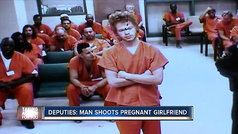 Man shoots pregnant girlfriend