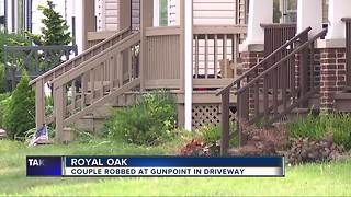 Royal Oak couple robbed at gunpoint in their driveway