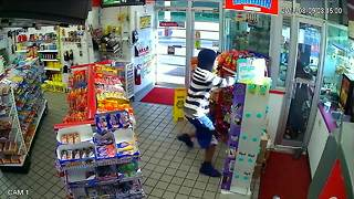 Video shows armed robbery at Raytwon gas station