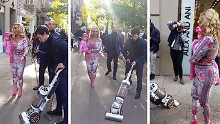 Bizarre footage shows helper vacuuming pavement in front of Ice-T's wife - Video