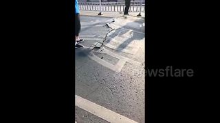 Heatwave in China causes bridge to buckle - Video