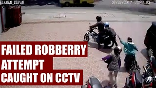 Like Movie Scene - Failed Robbery Attempt Caught on CCTV - Video